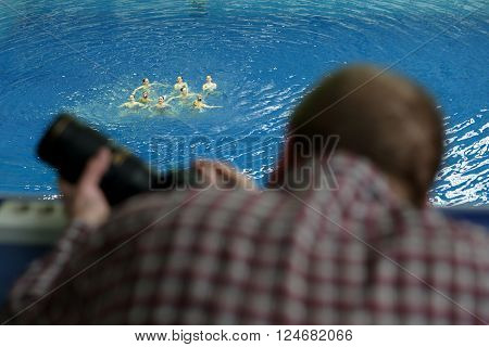 Photographer At The Competition In Swimming