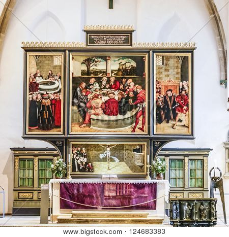 WITTENBERG GERMANY - MAR 25 2016: famous altar from Lucas Cranach in the civic church in Wittenberg Germany. The first mention of the Pfarrkirche St.-Marien dates to 1187.