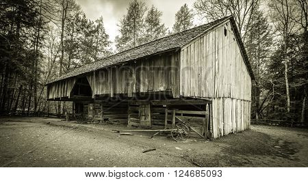 Down On The Farm. 18th century pioneer barn in the Cades Cove area of the Great Smoky Mountains National Park. Gatlinburg, Tennessee. This is a public display in a national park and not private property.