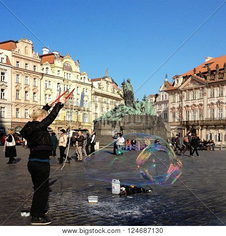 PRAGUE CZECH REPUBLIC - NOVEMBER13 2012 : Unidentified woman makes soap bubbles in Old Town Square in Prague Czech Republic