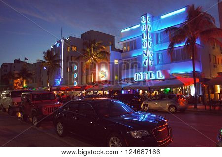 MIAMI BEACH, UNITED STATES - FEBRUARY 5: People and cars move alongside the night Ocean Drive street on 5th of February, 2016 in Miami Beach.