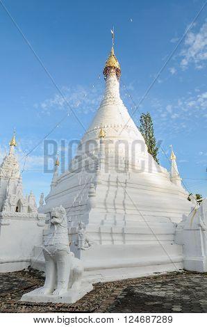 Lion statue and white pagoda at Wat Phra That Doi Kong Mu Mae Hong Son,  Thailand.