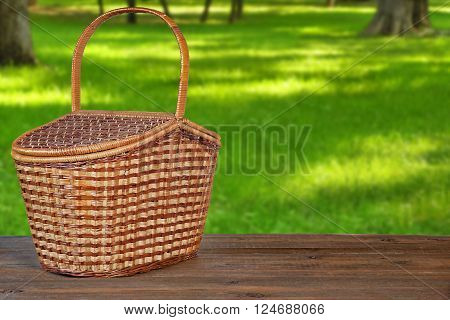 Picnic Basket Or Hamper On  Wooden Bench In Park