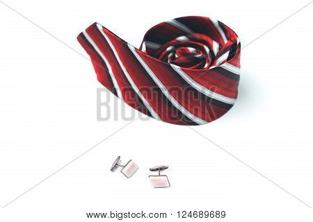 Tie And Cufflinks On A White Background
