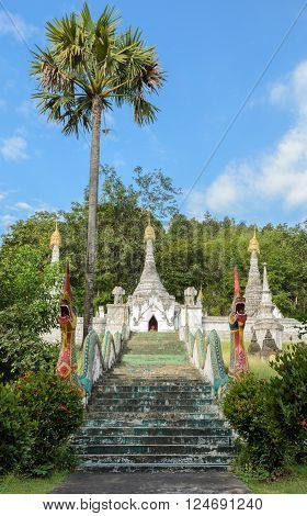 Ancient white Burmese style pagoda in Thailand