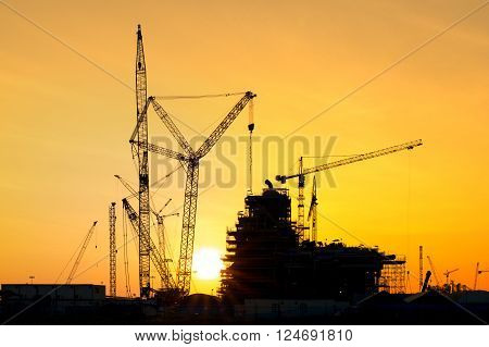 Silhouette of construction site in sunset time