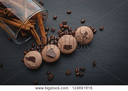 French macaroons with coffee beans over black