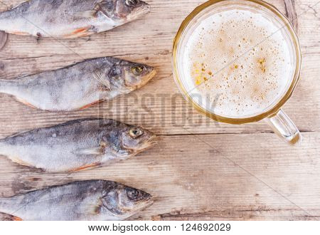 beer and fish on the table top view