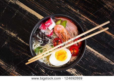 Asian Noodle Soup In A Black Bowl