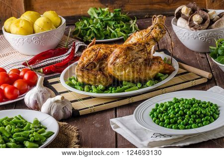 Feast - grilled chicken with potatoes vegetables and wine