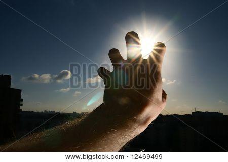 hand take the sun