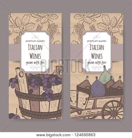 Set of 2 elegant Italian wine label templates with wine bottles in traditional cart and grapes in wooden bucket. Placed on cardboard background. Great for wineries, grocery stores, wine label design.