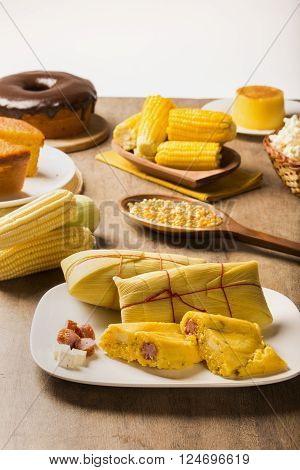 Salty Pamonha with sausage and cheese - typical food of green corn - tasty and cheap - typical and popular street food