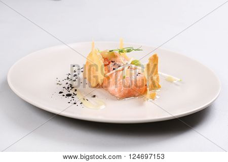 Smoked salmon with herbs, faked salmon roe. Sauce cooked by molecular gastronomy technic.