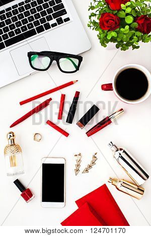 Still life of fashion woman, red objects on white