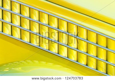 yellow and chrome art-deco style vehicle panel abstract