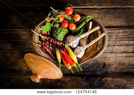 Condiments And Spices For Creative Cooking On Dark Rustic Wooden