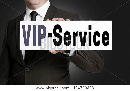 vip service sign is held by businessman.