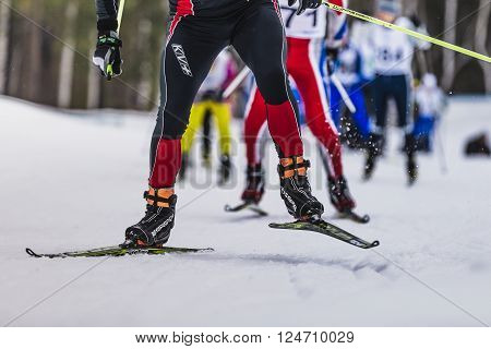 Kyshtym Russia - March 26 2016: group of skiers up mountainl during Championship on cross country skiing