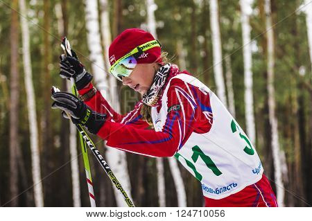 Kyshtym Russia - March 26 2016: closeup of girl skier in woods during Championship on cross country skiing