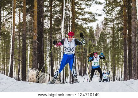 Kyshtym Russia - March 26 2016: old skiers male athletes up mountain during Championship on cross country skiing