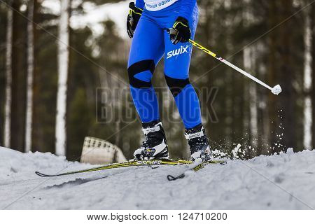 Kyshtym Russia - March 26 2016: young male athlete skier coming down mountain on skis during Championship on cross country skiing