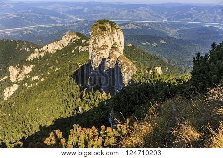 Summer mountain tower peak over dwarf pine trees