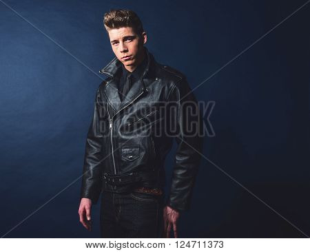 Cool Vintage Rock And Roll 50S Fashion Man Wearing Black Leather Jacket And Jeans.