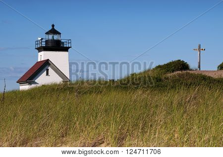 Long Point Light can be found from a two hour hike from Provincetown. There is a cross memorial on a hill nearby.