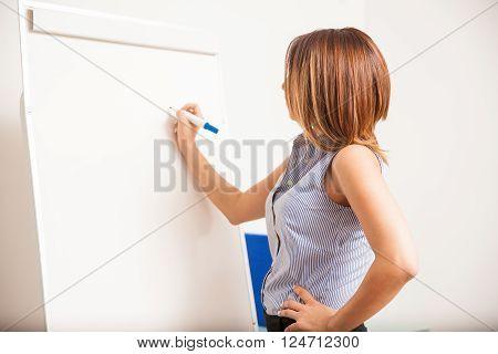 Pretty Teacher Writing On The Board