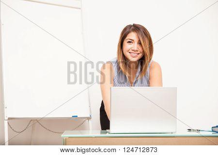Cute Female Teacher Preparing A Lesson