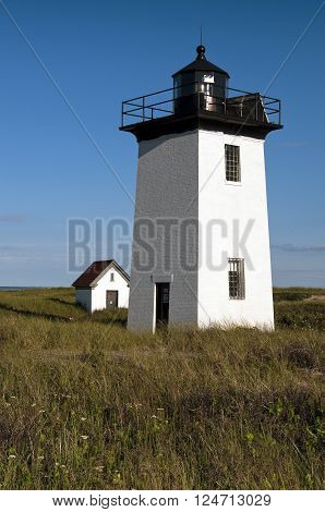 A favorite summer tourist attraction Wood End lighthouse tower sits at the end of Cape Cod, outside of Provincetown, in Massachusetts.