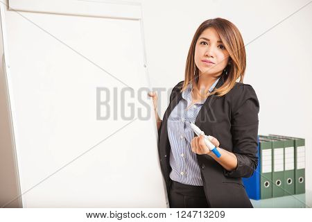 Businesswoman Giving A Presentation With A Flip Chart