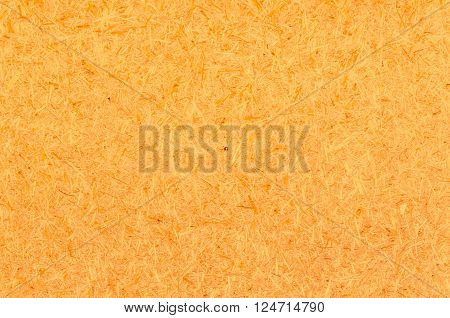 orange wood chippings board texture abstract background