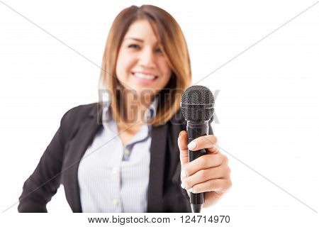 Female Presenter Handing Over The Microphone