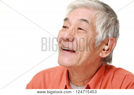 portrait of  senior Japanese man with hearing aid