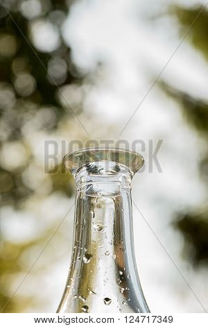 Water drops on a glass bottle with outdoor background
