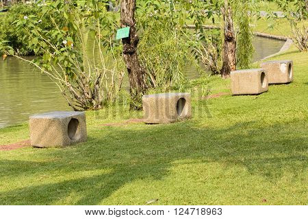 Rock chairs in garden on a nature background.