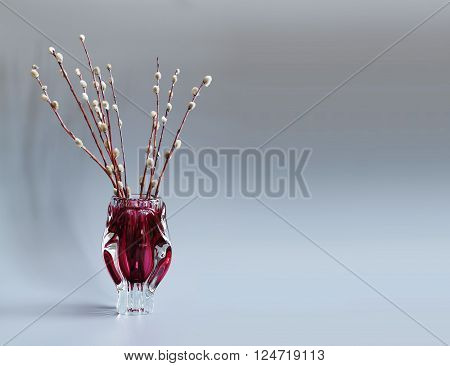 Pussy-willow tree branch in red vase. Twigs of willow, symbol Palm Sunday holiday. gray background.