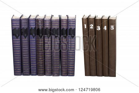 Used books volumes with numbers on covers. Eight turquoise color, five brown cover book collection. White background, isolated
