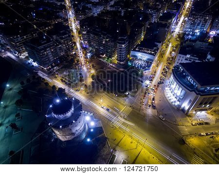 Thessaloniki Greece - January 29 2016: Aerial view of city Thessaloniki at night Greece.. Image taken with action drone camera causing distortion and blur.