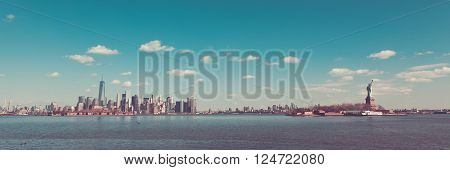 New York City is viewed on a beautiful day from Liberty State Park in Jersey City New Jersey. 432 Park Freedom Tower Ellis Island Brooklyn and the Statue of Liberty are all seen in this sweeping panorama.