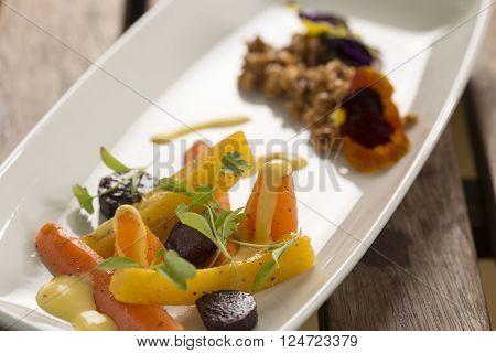 Heirloom Carrots with nasturtium crumble & saffron aioli ** Note: Shallow depth of field