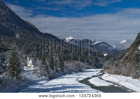 Panoramic view of the alpine village of Bagni di Lusnizza and the Fella River from the bridge of the Alpe Adria cycle route