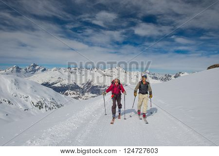 Two old men in form practice ski mountaineering