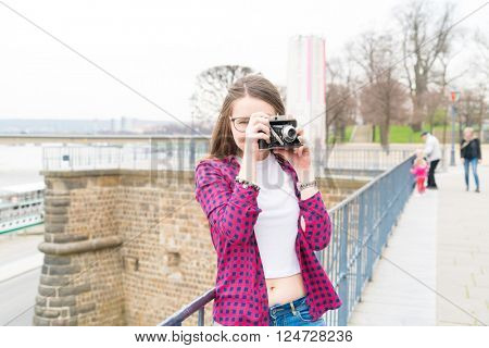 Woman tourist photographed retro camera historic part of the city, Dresden, Germany