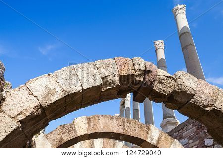 Ancient Columns And Arches Over Blue Sky