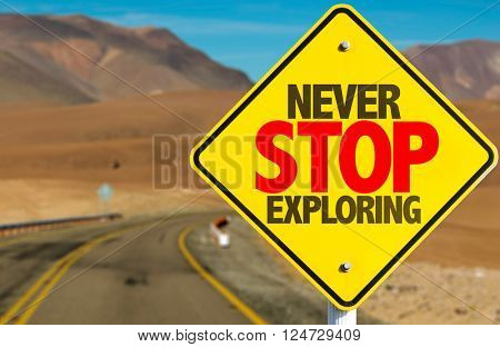 Never Stop Exploring sign on desert road