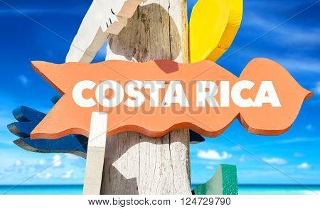 Costa Rica signpost with beach background