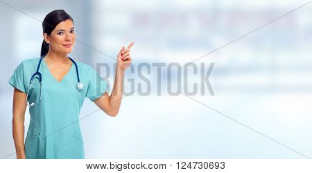 Doctor woman showing advertising space.